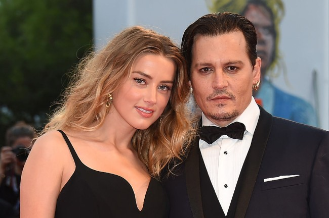 Amber Heard in a swimsuit seen on CCTV with Elon Musk in Johnny Depp's apartment.