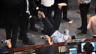 We've Got Politicians Climbing Walls In A Classic Scuffle In The Hong Kong Legislature