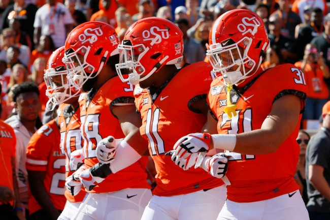 oklahoma state football players tests positive for coronavirus
