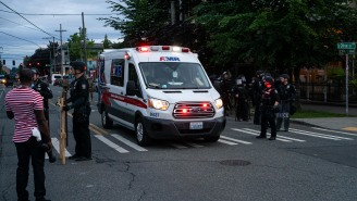 Protester Gets Shot In The Arm Trying To Stop Man From Driving Car Into Large Crowd In Seattle