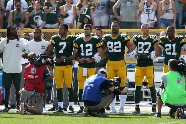 Aaron Rodgers Responds To Drew Brees' Flag Comments 'It Has Never Been About an Anthem or a Flag'