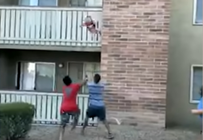 Football player catches toddler