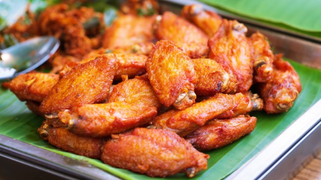 Uber Eats driver gets caught chowing on a customer's chicken wings