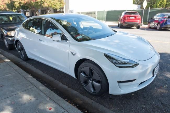 Tesla Crashes Into Cop Car