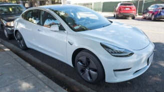 Tesla Crashes Into Cop Car While On Autopilot And Driver Was Too Busy Doing Something Stupid To Prevent Collision