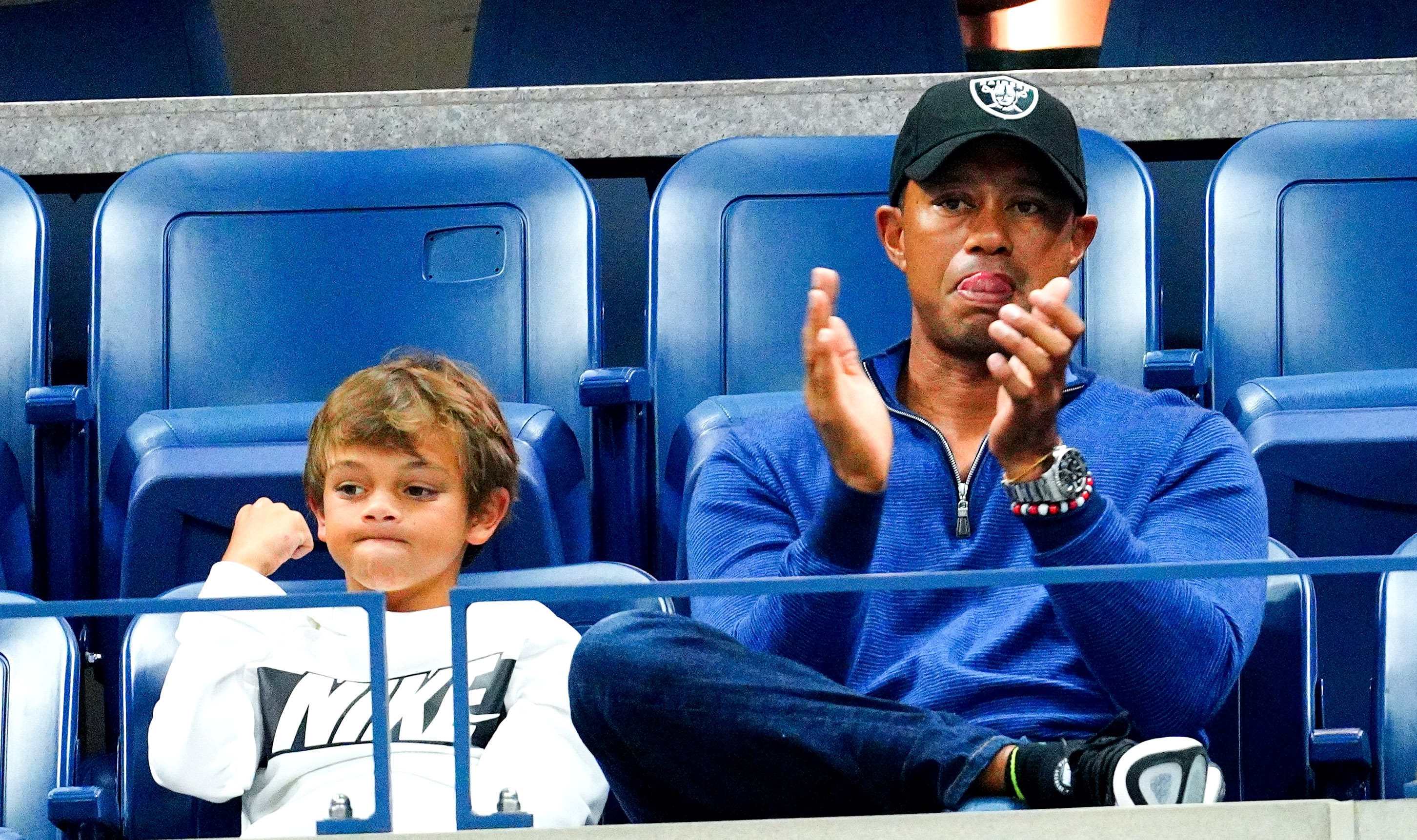 Tiger Woods And Son Charlie Put On A Stripe Show At The Driving Range At PNC Father-Son Challenge
