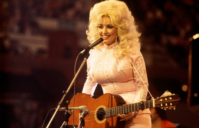 Dolly Parton addresses rumors she's covered in tattoos with a 'tasteful' tease