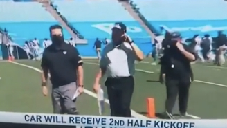 Here's Why Jon Gruden Was Talking On A Cellphone Heading Into Halftime
