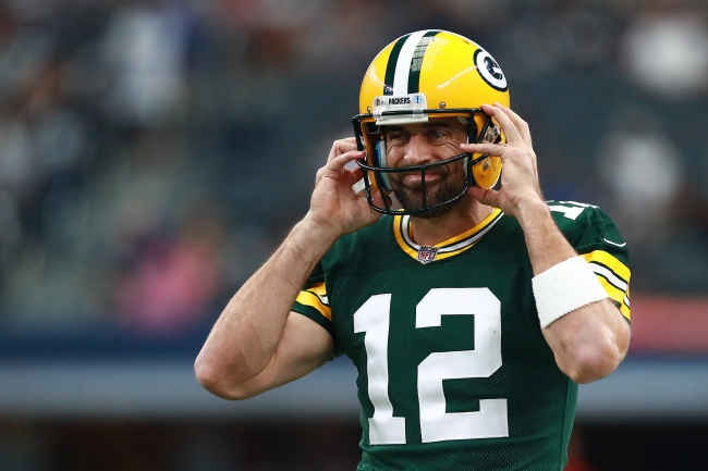 Packers quarterback Aaron Rodgers admits he'll fake a helmet malfunction in order to call his own plays on offense