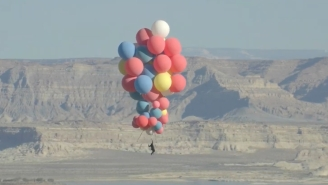 WATCH: David Blaine Is Currently Performing A Stunt Where He'll Ride 52 Helium Balloons 18,000 Feet High