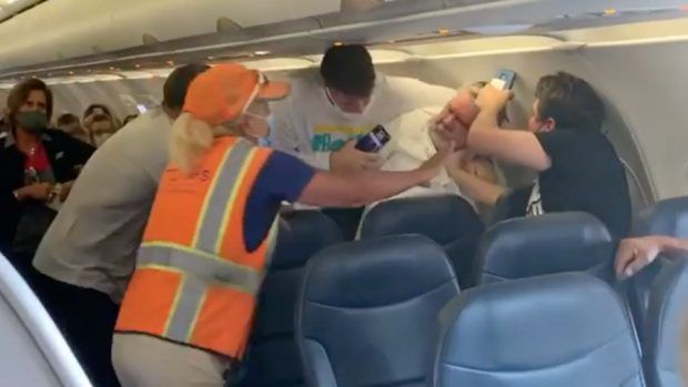 Fight erupts on flight after man wearing face shield refuses to wear mask