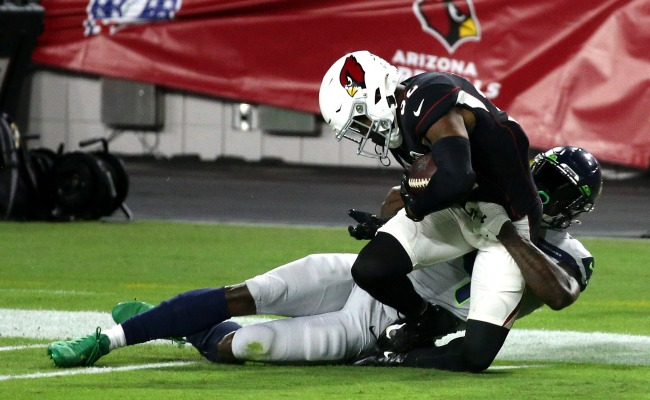 Listen To Audio Of Budda Baker's Shocked Reaction To Being Run Down By D.K. Metcalf