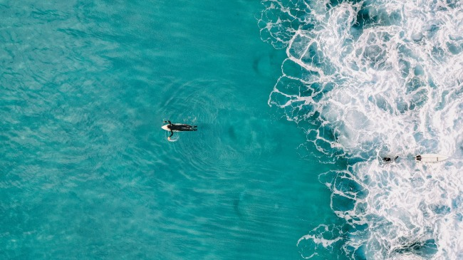 drone footage of surfer