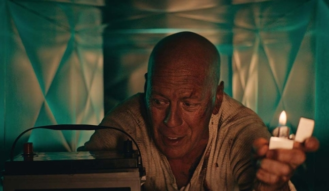Bruce Willis reprises role as John McClane for Die Hard battery commercial.