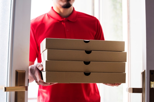 The U.K. branch of Domino's is investigating after a pizza delivery driver was caught on camera rubbing a customer's food on his crotch and then handing over the order.