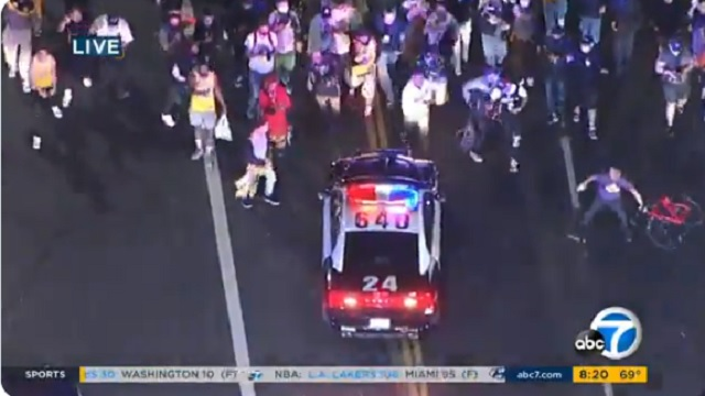 Rowdy Lakers Fans Throw Objects At Police Cars During Championship Celebration In LA
