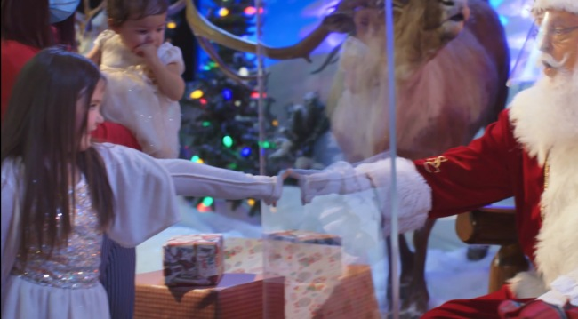 Some Store Santas Will Be Inside Glass Boxes Because Of COVID