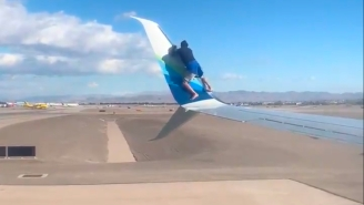 Guy Climbs On Wing Of Plane Before Takeoff, Obviously Doesn't Know How Planes Work