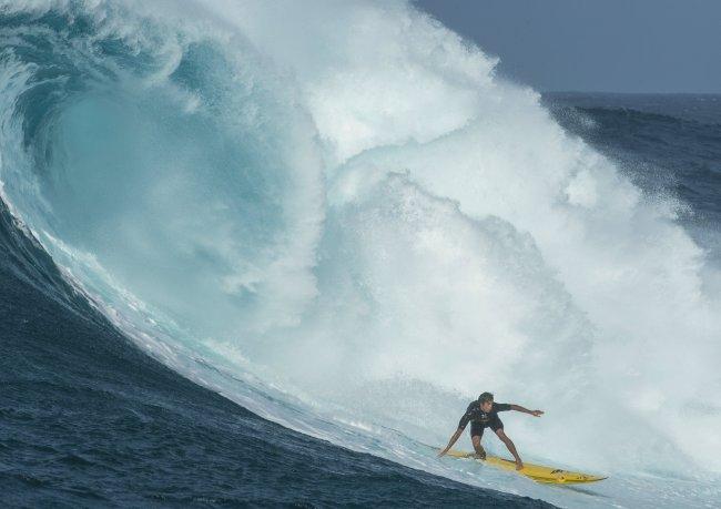 Kai Lenny surfing Jaws