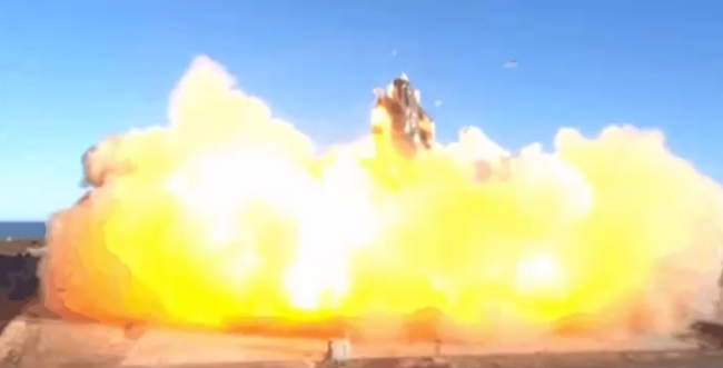 SpaceX launched its latest Starship prototype bursts into flames and explodes on impact in failed landing.