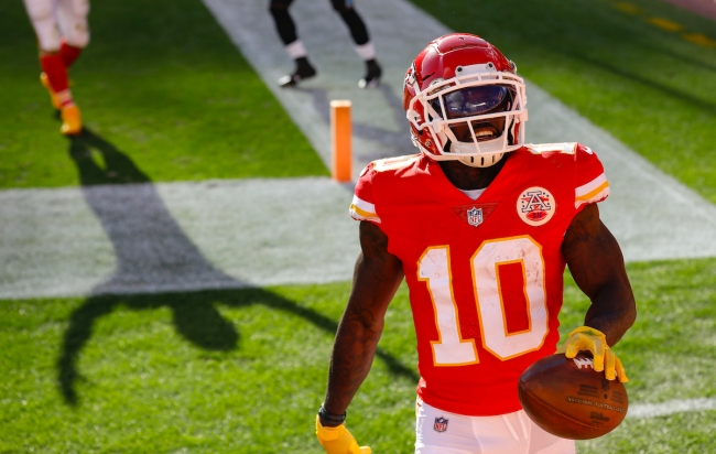 Chiefs wide receiver Tyreek Hill gives his parameters for a 100-yard race against ESPN reporter Adam Schefter