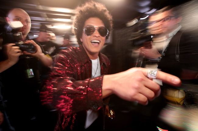 A north Texas woman reportedly coughed up $100,000 to a catfishing con that convinced her she was in an online romance with Bruno Mars.