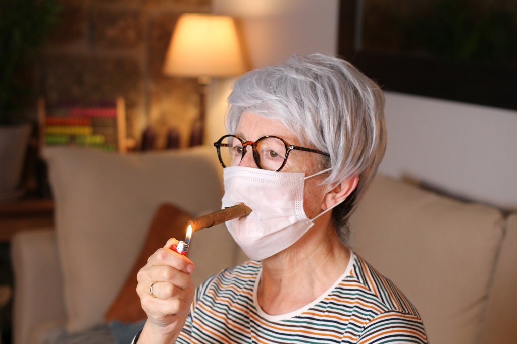 elderly woman smoking a cigar