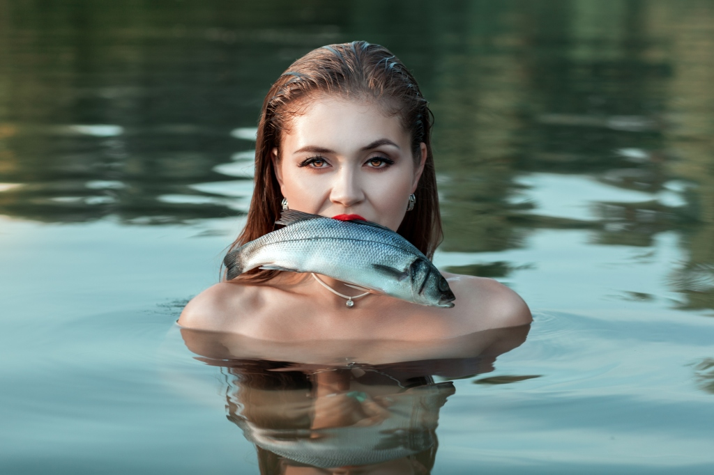 girl with fish in her mouth