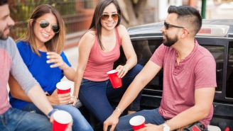 Friends And Family Enjoy Full-Scale Tailgate Party At Hospital Parking Lot Waiting For Birth Of Baby