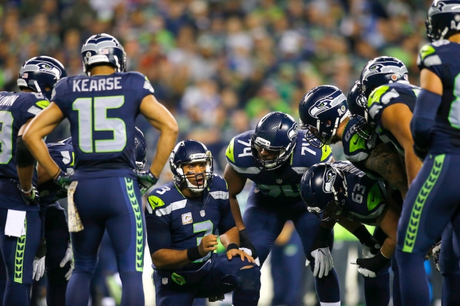 Seahawks defender Carlos Dunlap claims quarterback Russell Wilson has been telling teammates he's committed and isn't looking for a trade this NFL offseason
