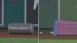Security Forced To Guard Outfield Wall Because Angels Fans Couldn't Stop Throwing Trash Cans On The Field During Game Vs Astros