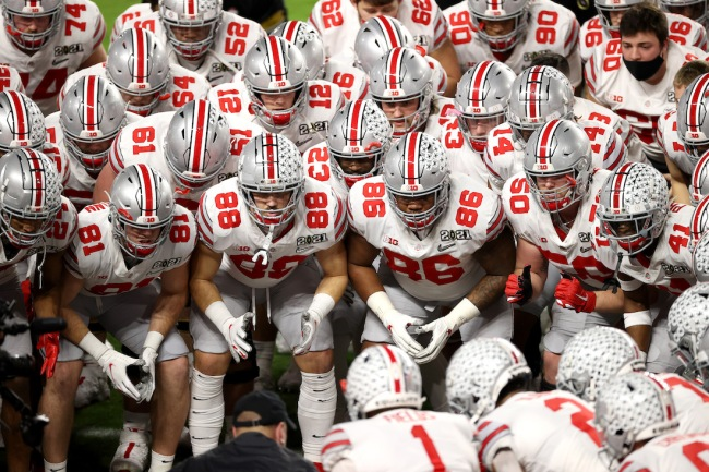 A 41-year-old woman in trouble after she reportedly solicited services to Ohio State football players in hopes of sexual favors in return