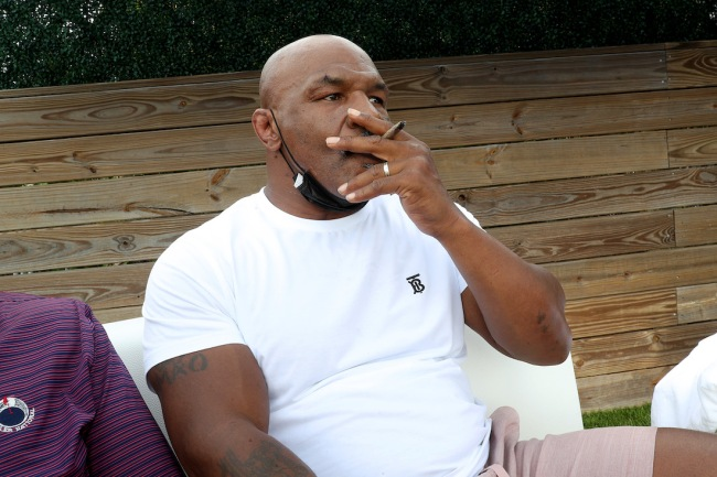 Boxing legend Mike Tyson claims he started dating a prison counselor while in jail and that some 'nasty stuff' led to a shorter sentence