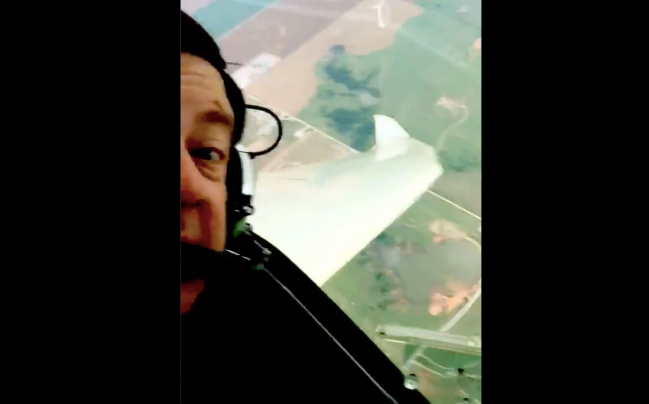 A pilot named David films himself circling a tornado while getting as close as possible to it