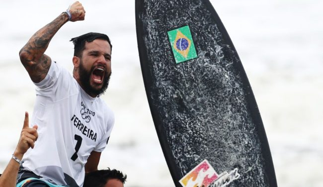 Tokyo 202 Brazil's Italo Ferreira, Gold medalist, celebrates on the podium at the Tsurigasaki Surfing Beach, in Chiba, on July 27, 2021 during the Tokyo 2020 Olympic Games. (Photo by Olivier MORIN / AFP) (Photo by OLIVIER MORIN/AFP via Getty Images)