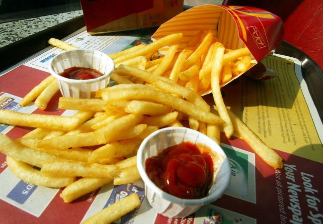 McDonald's hack from viral TikTok video on how to get free food, french fries refill policy.