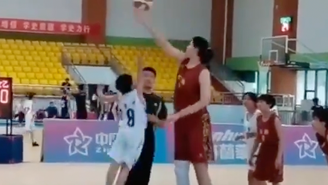 China's Newest Basketball Sensation Is A 7'4″ 14-Year-Old Girl And Her Highlight Reel Is Comedy Gold