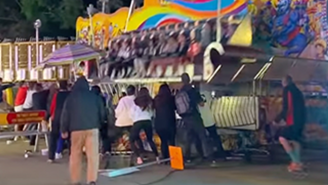 Shocked Spectators Scramble To Stop A Carnival Ride From Tipping Over In A Terrifying Video