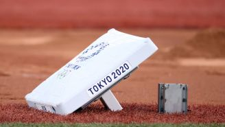 Pitchers At The Olympics Are Being Driven To The Mound In A Baseball Mitt Car