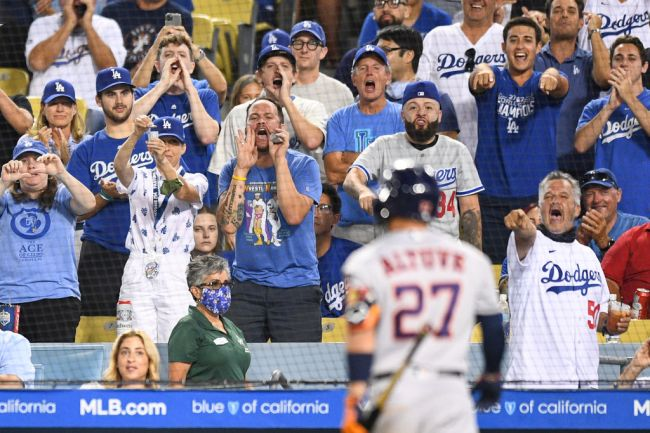 LOS ANGELES, CA - AUGUST 03: Dodger fans yell at Houston Astros second baseman Jose Altuve (27) as he walks to the dugout after he struck out during the MLB game between the Houston Astros and the Los Angeles Dodgers on August 3, 2021 at Dodger Stadium in Los Angeles, CA.