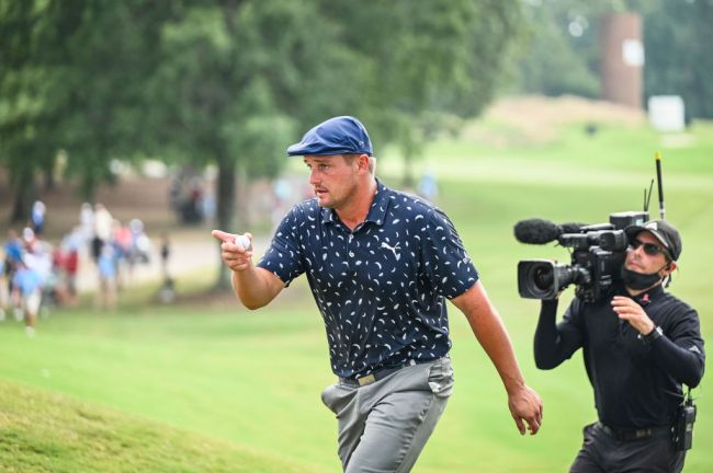 MEMPHIS, TN - AUGUST 08: Bryson DeChambeau points to a young fan to give his ball to on the ninth hole during the final round of the World Golf Championships-FedEx St. Jude Invitational at TPC Southwind on August 8, 2021 in Memphis, Tennessee.