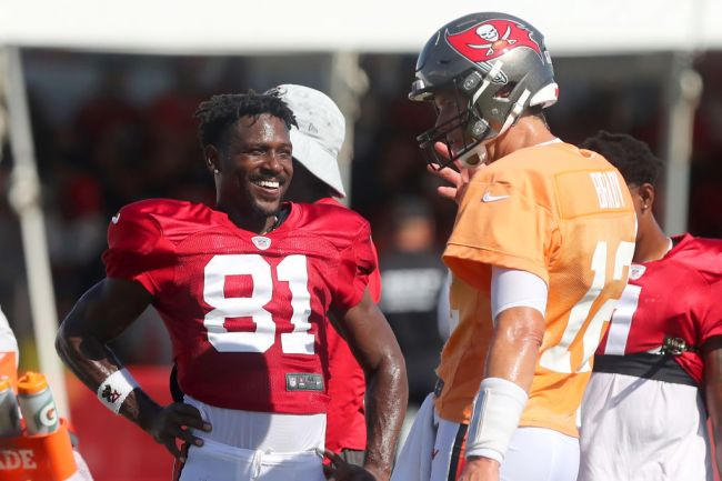 TAMPA, FL - AUG 18: Antonio Brown (81) of the Buccaneers smiles as he talks with Tom Brady (12) during the Tennessee Titans & Tampa Bay Buccaneers joint training camp on August 18, 2021 at the AdventHealth Training Center at One Buccaneer Place in Tampa, Florida. (