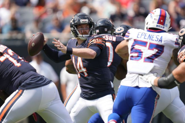 CHICAGO, IL - AUGUST 21: Chicago Bears quarterback Andy Dalton (14) throws the football during a preseason game between the Chicago Bears and the Buffalo Bills on August 21, 2021 at Soldier Field in Chicago, IL.