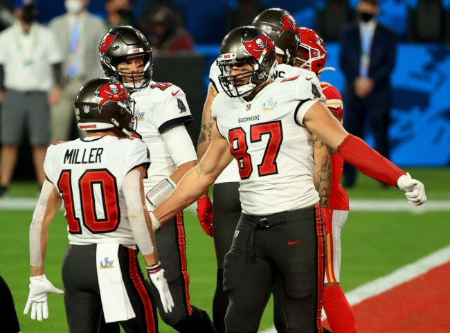 TAMPA, FLORIDA - FEBRUARY 07: Rob Gronkowski #87 of the Tampa Bay Buccaneers celebrates a touchdown with Scotty Miller #10 following a touchdown during the second quarter against the Kansas City Chiefs in Super Bowl LV at Raymond James Stadium on February 07, 2021 in Tampa, Florida.