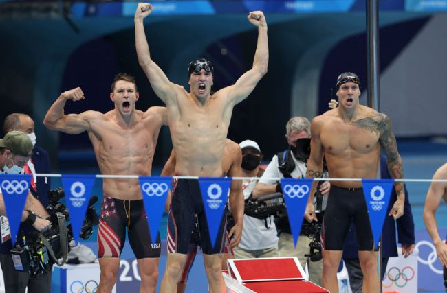 TOKYO, JAPAN - AUGUST 1: Gold Medalists of Team USA - Caeleb Dressel; Michael Andrew; Ryan Murphy; Zach Apple - celebrate winning the Men's 4 x 100m Medley Relay Final on day nine of the swimming competition of the Tokyo 2020 Olympic Games at Tokyo Aquatics Centre on August 1, 2021 in Tokyo, Japan.