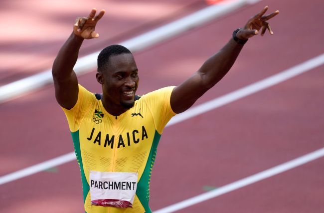 TOKYO, JAPAN - AUGUST 05: Gold medalist Hansle Parchment of Team Jamaica celebrates after competing in the Men's 110m Hurdles Final on day thirteen of the Tokyo 2020 Olympic Games at Olympic Stadium on August 05, 2021 in Tokyo, Japan.