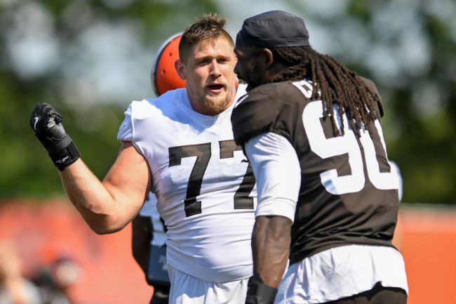 BEREA, OH - AUGUST 03: Offensive guard Wyatt Teller #77 of the Cleveland Browns jokes with defensive end Jadeveon Clowney #90 during Cleveland Browns Training Camp on August 3, 2021 in Berea, Ohio.