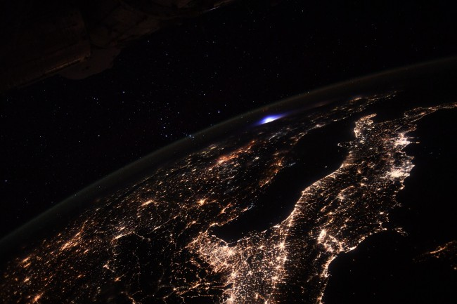 European Space Agency ESA astronaut Thomas Pesquet took photo of blue light from International Space Station ISS as transient luminous event.