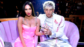 Machine Gun Kelly Pelted With Bottles And Tree Branches As He Flips Off Haters