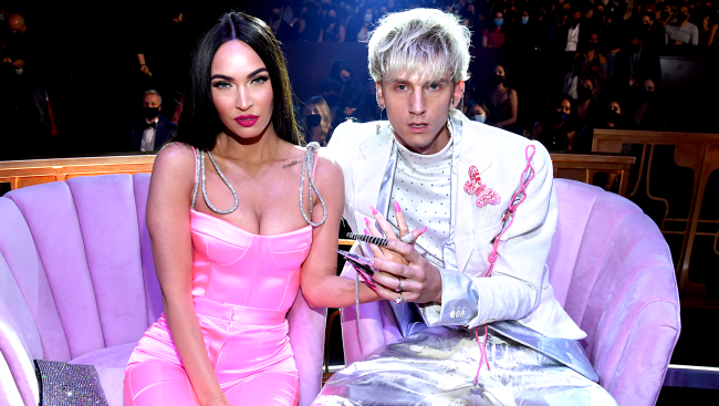 Machine Gun Kelly Pelted With Bottles And Tree Branches After Flipping Off Haters